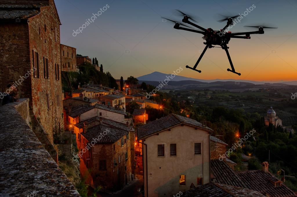 depositphotos_57843727-stock-photo-flying-drone-in-the-sunset